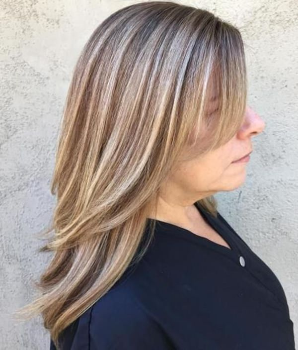 Nothing will brighten up your style more than some bold blonde highlights. These ones just pop right off adding a lot of dimension to her style.
