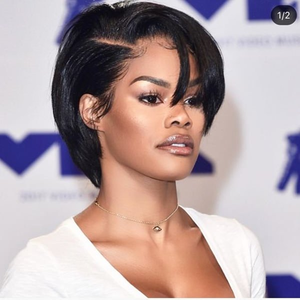 A short style that is straight and styled into a bob. It has a deep part which gives it lots of volume.
