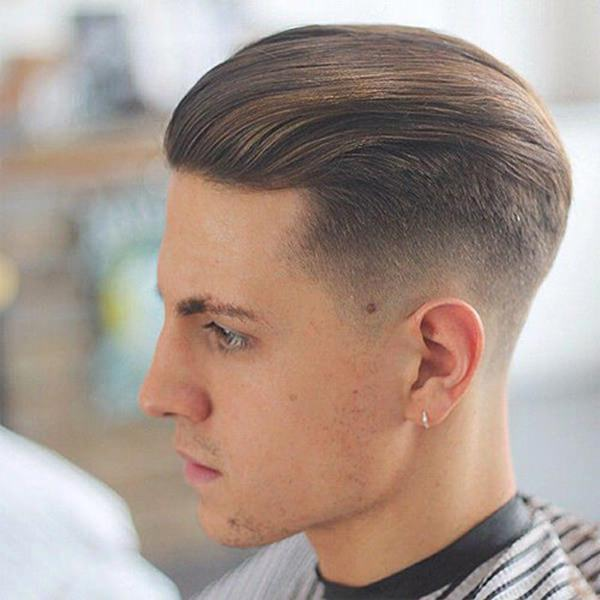 A Fade Like This Is Clean On The Sides And Very Long On The Top. The Hair  Is Styled Back Into A Very Different Look.