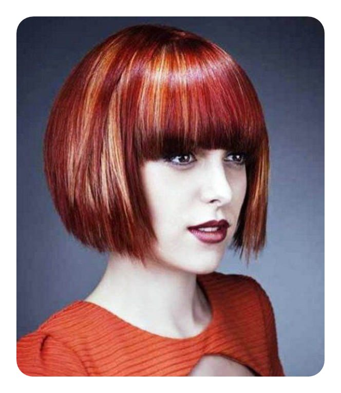 Short Cropped Red Hairstyle With Wispy Fringe And Blonde Highlights