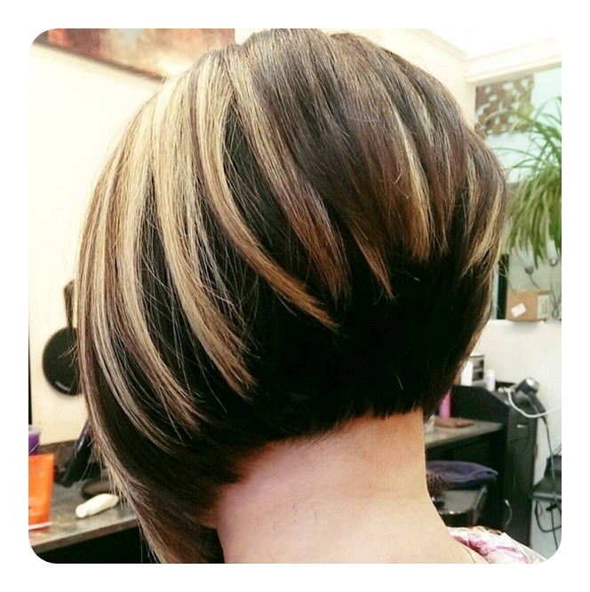 This is a super short bob that is angled quite high in the back. The highlights really make the angles stand out. If you want a dramatic style, ...